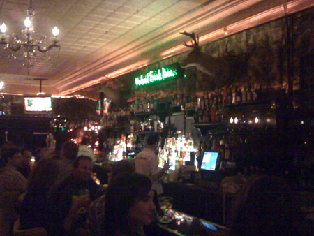 Another shot of the bar, complete with deer head.